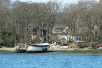 This house & boat are just outside the entrance to Birdham pool Marina in Chichester Harbour