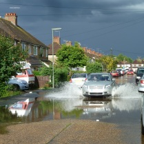 Another evening a flash rainstorm flooded the roads and some of the houses on this road!