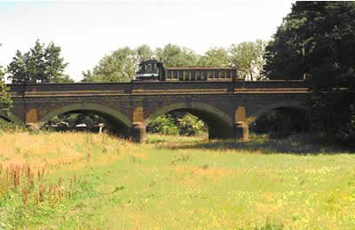 Construction included a brick arch viaduct on the Walton side across the flood plain. This structure is still standing today on the Walton approach to the bridge.