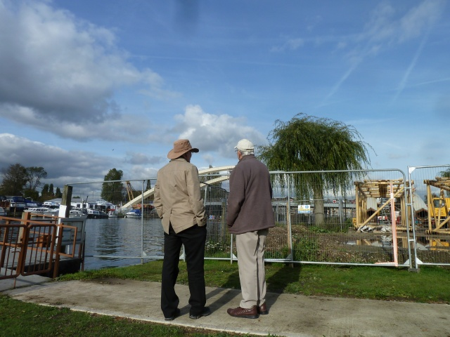 My dad (left) with another construction fan, discussing the new bridge