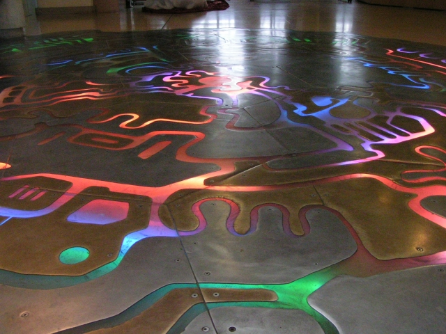 The floor of the Visitor Centre in CERN.  The floor lights up in different places in response to the detection of cosmic rays