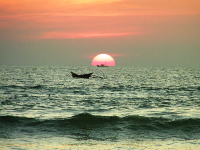 A boat crossing the sunset, Goa, India