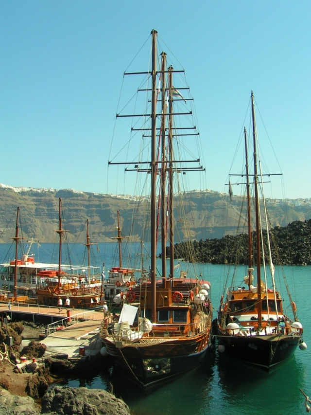 Masts of tall ships visiting the centre of the volcano